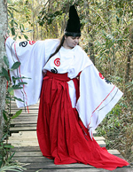 Elionora of Kisimull poses on the bridge in the woods at Camp Wilkes to display her elegant oriental garb.